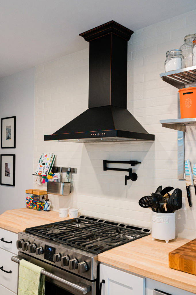 black range hood white kitchen