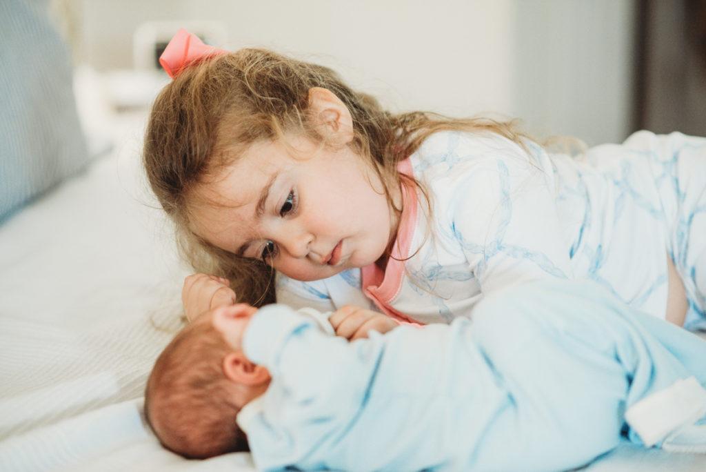 newborn boy with toddler sister